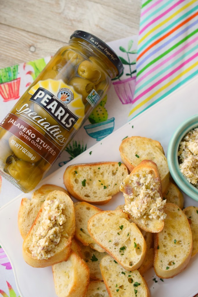 Spicy Green Olive & Feta Tapenade is a great spread to enjoy when entertaining. Easy to make, your guests will love this dip with crusty baguettes.