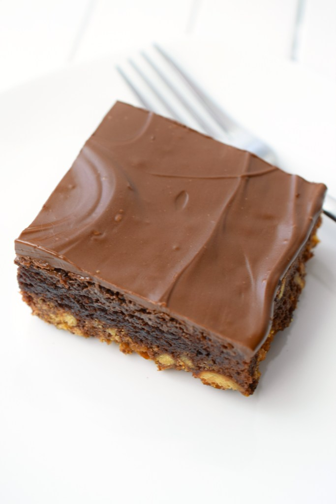 Triple Layer Frosted Brownies, an easy to make decadent treat that you'll love. With a pretzel crust, brownie layer and frosting, this is a yummy dessert!
