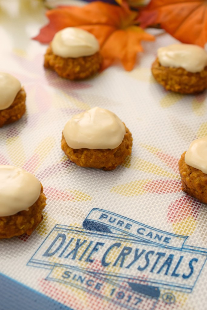Chai Frosted Pumpkin Oatmeal Cookies, a tasty fall treat loaded with great flavors. Tender cookies and a chai tea infused frosting make a delicious dessert.