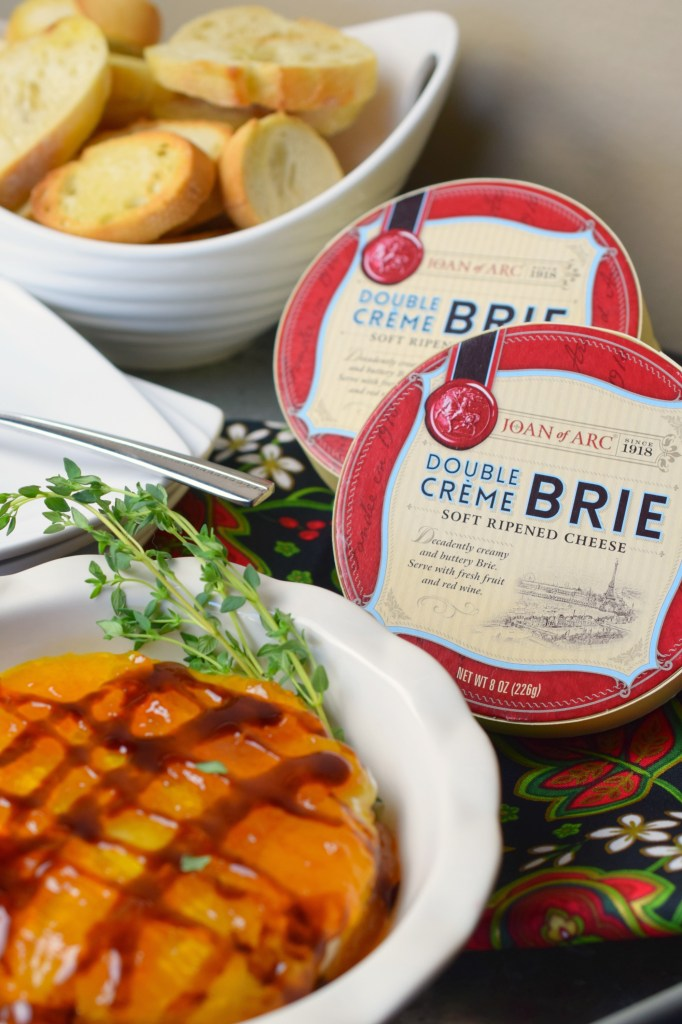 Baked Peach Balsamic Brie is such an easy appetizer that guests will love! Ready in a snap, it is party perfect and great for the holidays.