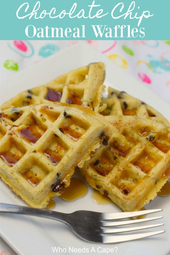 chocolate chip oatmeal waffles on white plate with fork sitting on coloful fabric