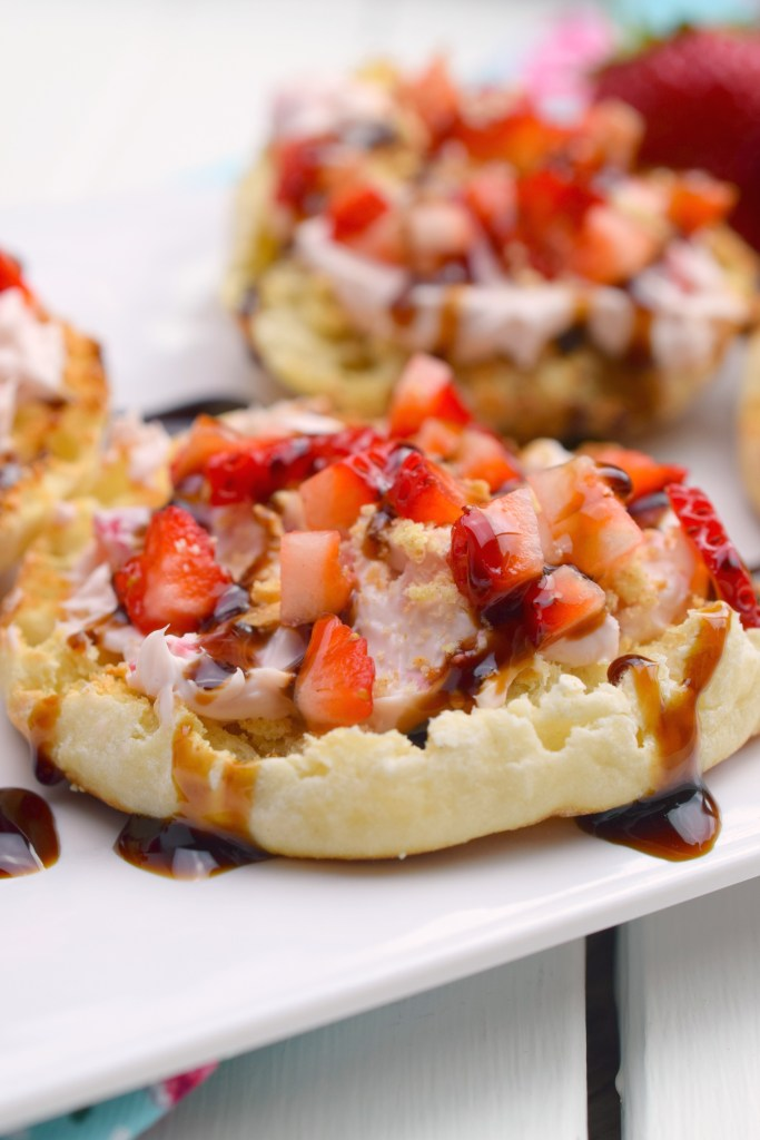 english muffin with diced strawberry, cheesecake topping and balsamic vinegar glaze
