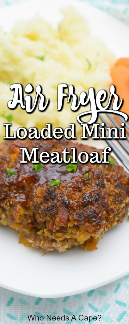 mashed potatoes, carrots, fork and mini meatloaf plated on white dish