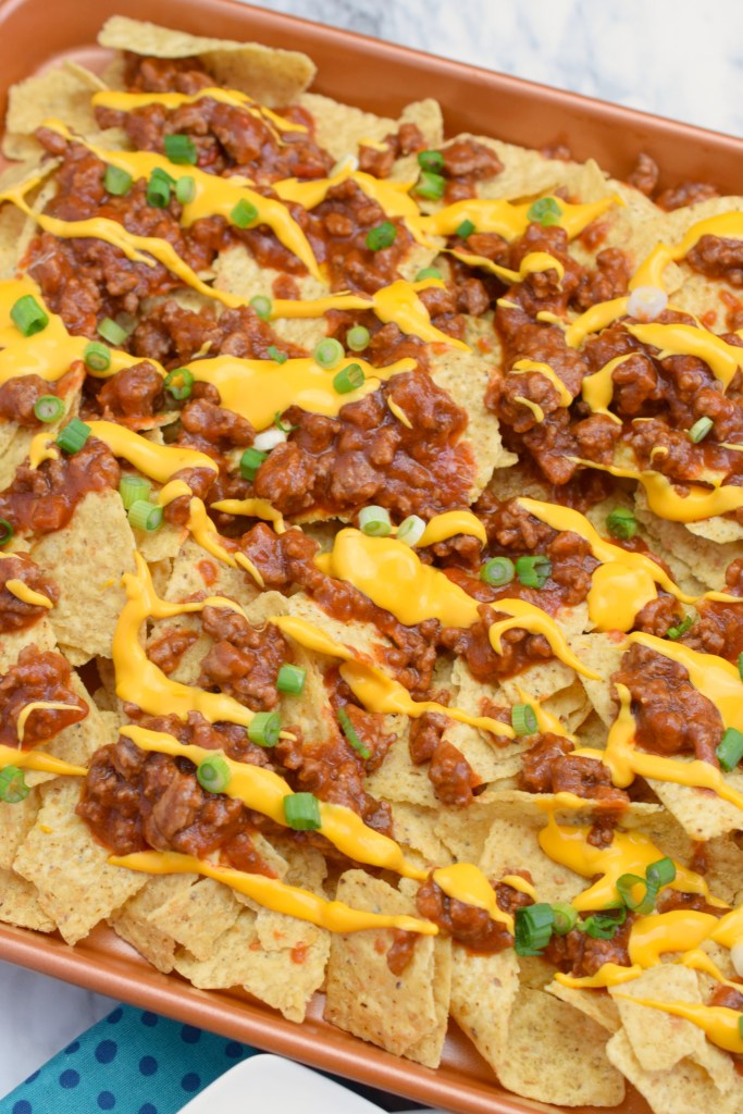 full tray over head shot of finished nachos