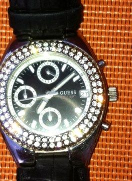 Sabine:So, here it is, my belowed arm watch. It is very masculine, big, black, serious... But surrounded with sparkling stars it gets also something very feminin. Don't you think so? It must have to do with my personality as since about 8 years I was never interested to get a new arm watch.