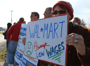 Walmart workers picket for higher pay.