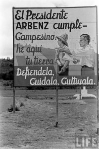 """President Arbenz delivers on his promise — Farmers: here is your land. Defend it, care for it, cultivate it."" (1954) One of a series of photos by Cornell Capa, documenting the sweet,short-lived dream of life under a democracy. Photo credit: Cornell Capa"