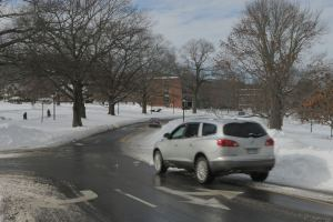 Cars have to cross lanes where snow is not cleared from the road. (Photo by Charlie Smart)