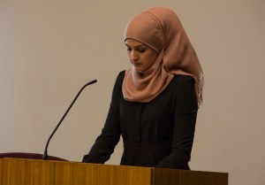 UConn alumna and board member of the Muslim Coalition of Connecticut Rebecca Minor spoke at Monday night's vigil to touch on the lessons that can be learned from the Chapel Hill killings. (Photo by Kaitlin Carroll)