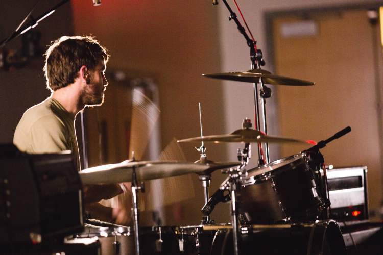 Sam Frederick plays drums in The Hotelier.