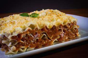 A photo of a cooked lasagna on a plate