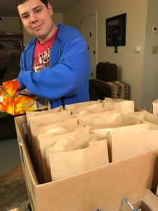 Gabe packing Snack and Sock Bags