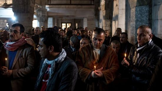 Iraqis attend Christmas Mass at the Mar Shimoni church in Bartella, a predominantly Christian town recently recaptured from Islamic State. (Chris McGrath / Getty Images)
