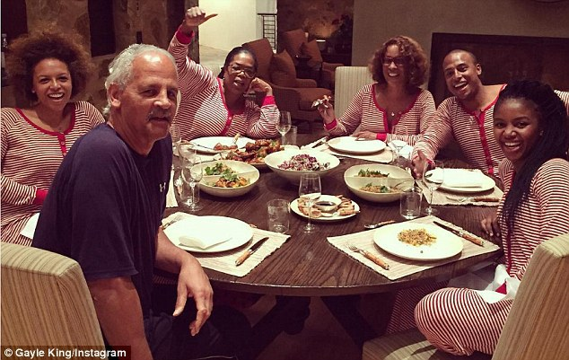 Family: Gayle King posted a photo of herself and Oprah Winfrey in matching onesie pajamas on Thursday (clockwise from center: Oprah, Gayle, William Bumpus Jr., guest, Stedman Graham and Kerby Bumbus)