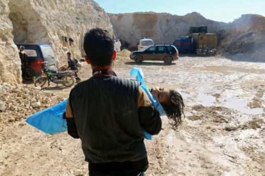 (PHOTO: REUTERS/AMMAR ABDULLAH) A man carries the body of a dead child, after what rescue workers described as a suspected gas attack in the town of Khan Sheikhoun in rebel-held Idlib, Syria April 4, 2017.