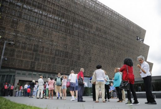 FILE- In this May 1, 2017, file photo, people wait in line to enter the Smithsonian National Museum of African American History and Cultural on the National Mall in Washington. (Pablo Martinez Monsivais, File/Associated Press)