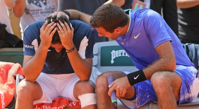 Juan Martín del Potro, right, comforted Nicolás Almagro after he collapsed with a left knee injury in their match at the French Open on Thursday. (David Vincent/Associated Press)