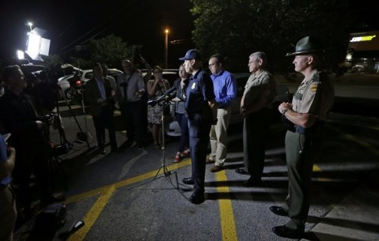 Tennessee Bureau of Investigation Director Mark Gwyn, center, speaks during a news conference held at a truck stop Thursday, June 15, 2017, in Christiana, Tenn. (Mark Humphrey/Associated Press)
