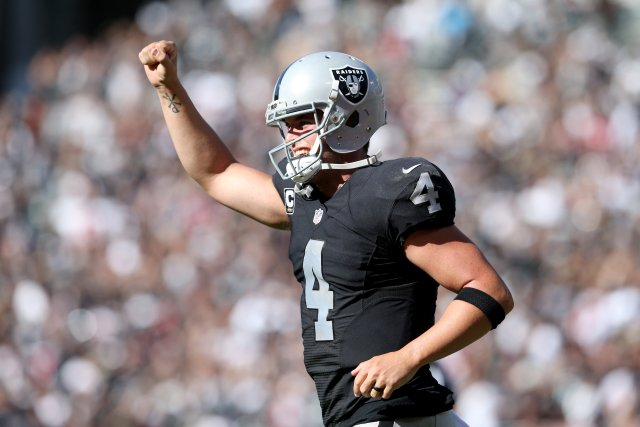 Oakland Raiders quarterback Derek Carr (4) celebrates a touchdown by teammate Michael Crabtree (15) in the fourth quarter of a NFL game against the Atlanta Falcons at the Coliseum in Oakland, Calif., on Sunday, Sept. 18, 2016. (Anda Chu/Bay Area News Group)