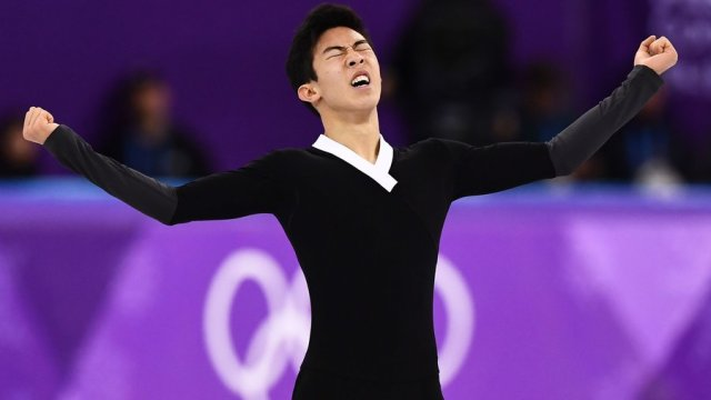 """""""I just wanted to leave here satisfied with what I have done and I definitely am,"""" Nathan Chen said, after rebounding from a rough short program to make a personal-best score in the men's free skate. Aris Messinis /AFP/Getty Images"""
