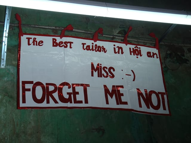 Miss Forget Me Not sign at the Cloth Market - The Darker Side of Hoi An Tailors