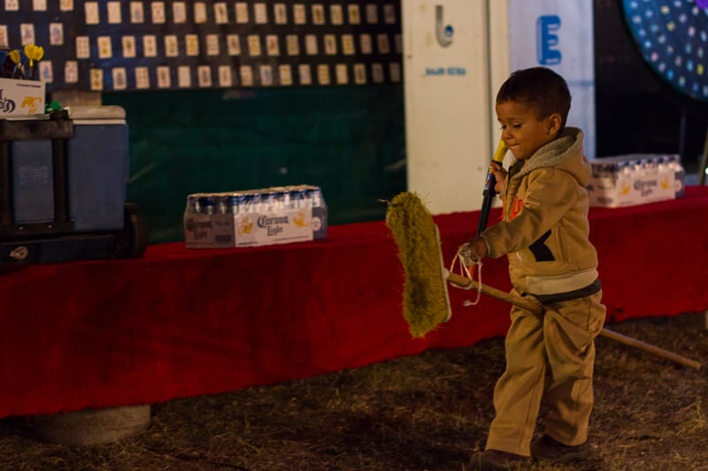 A Little Boy Playing With a Broom at Sayulita Days