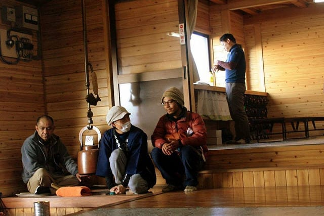 Hikers in one of the huts on Mt. Fuji - How to Summit Mt. Fuji