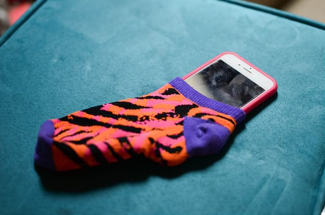 Use your socks to protect your electronics and you will find out why they are one of our essential travel items