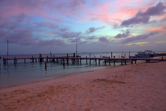 Sunset over a Pier - How to Travel Slow On a Short Trip