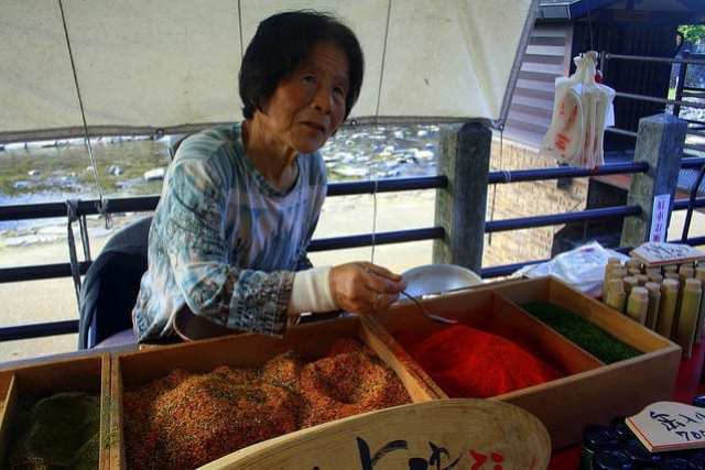 A Women Selling Spices on the Street in China - How to Travel Slow on a Short Trip