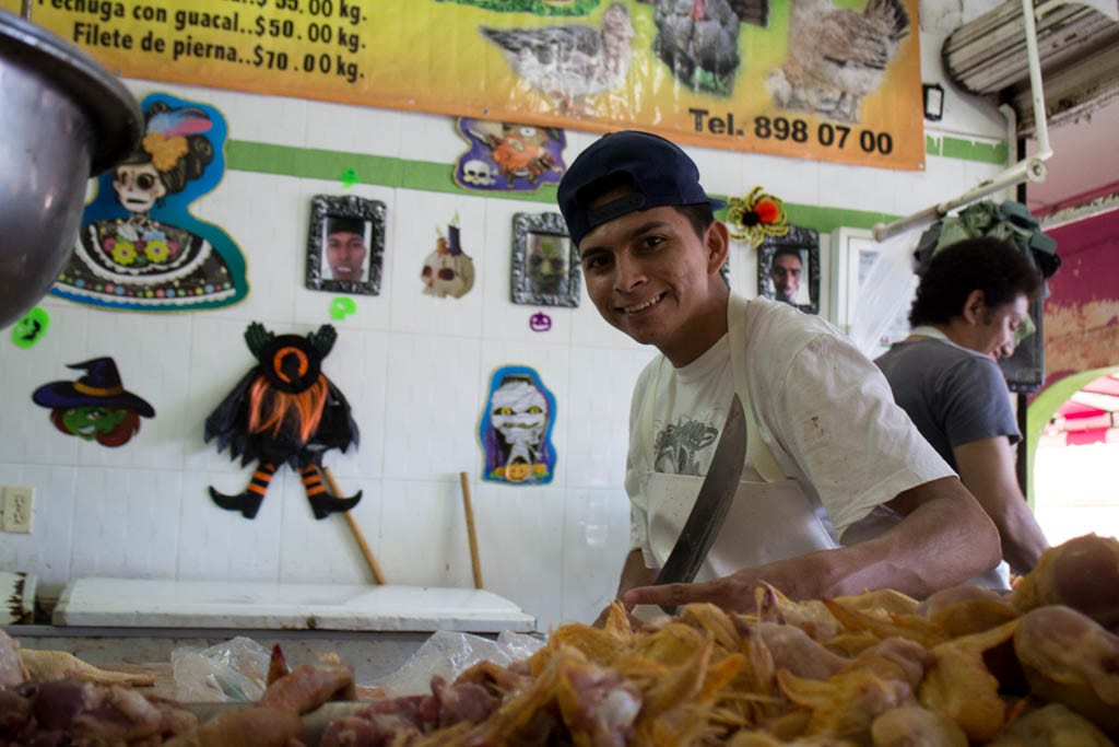 A Man breaking down chicken at the Market in Cancun