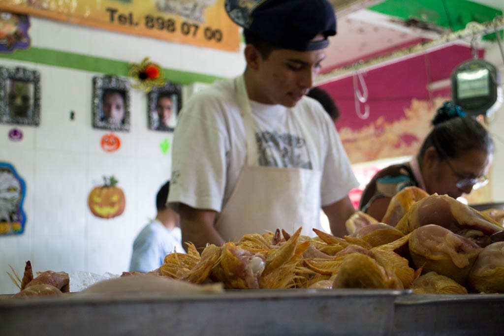 Workers breaking down chickens at the market in Cancun