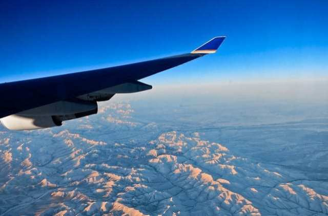 View of the Mountains from Out An Airplane Window - How to Survive a Long Flight