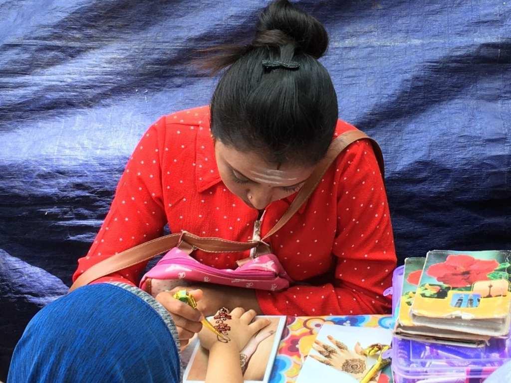 A henna artist working at the Ramadan market in Kuala Lumpur