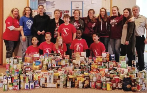 Madison Mustangs Pathfinders Collect 690 Food Items for Families in Need