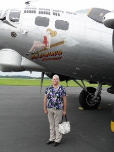 Photo by 2nd Lt. Lad Vrany - 2nd Lt. LuAnn Vriezen stands in front of a B-24 Liberator, a plane that her father was a navigator in during WWII.