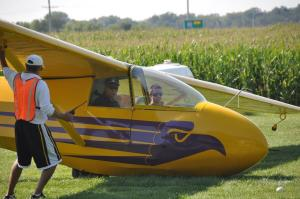 Photo by Maj. Todd Mandel - Cadet Captain Michael Cunningham waits with Senior Member Michael Vaughn after a successful landing. (Cadet Cunningham is from La Crosse)