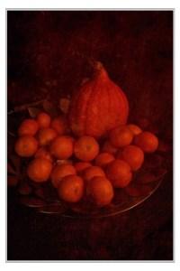 Pompoen en mandarijnen op een schaal