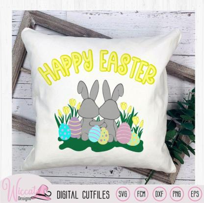 Two little bunnies in a flower field with Easter eggs,
