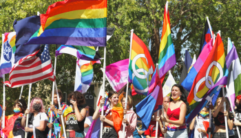 Hundreds of people marched along Main Street during the Wichita Pride parade on Sept. 26 just days ahead of a Wichita City Council vote on an LGBTQ-inclusive nondiscrimination ordinance. (Matt Hennie/The Beacon)