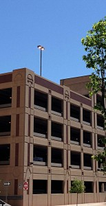 On a sunny afternoon in May 2014, the City of Wichita uses electricity to illuminate the roof of a parking garage it owns.