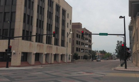 Looking south on Topeka from Broadway, May 29, 2015 at 11:25 am. Four burning street lights are seen here. There were dozens more further south.