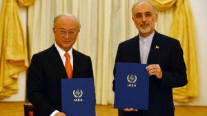 IAEA Director General Yukiya Amano and Vice President of the Islamic Republic of Iran Ali Akhbar Salehi signing a roadmap for the clarification of past and present issues regarding Iran's nuclear program in Vienna.