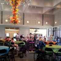 Guests sitting at colorful tables at Wichita Art Museum's free Summer Ice Cream Social