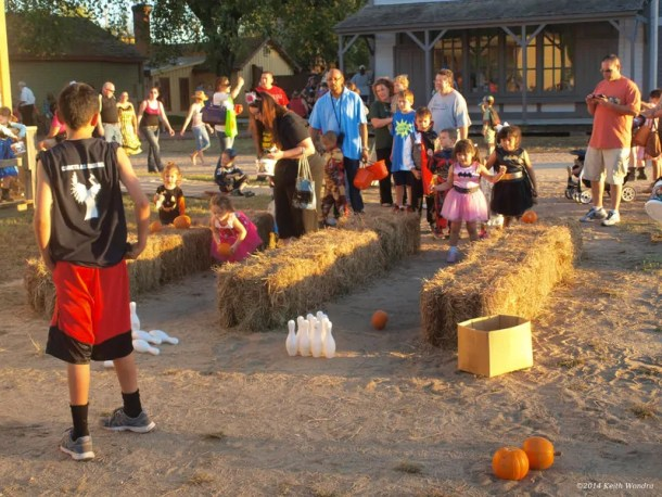 Kids pumpkin bowling at hay hooves halloween at the Old Cowtown Museum