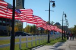 Waterwalk lined with flags for Veterans Day