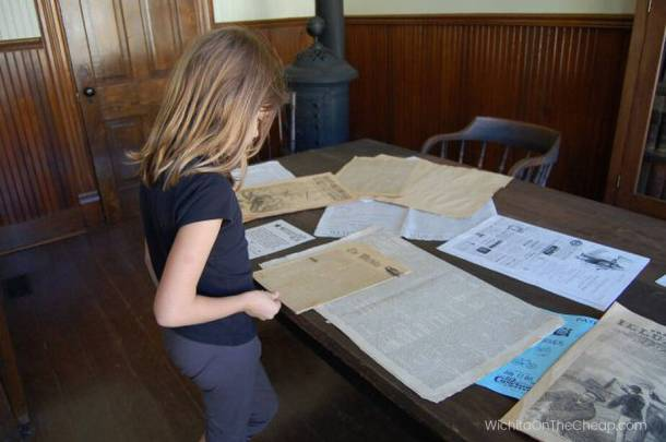 Perusing old newspapers at Old Cowtown museum
