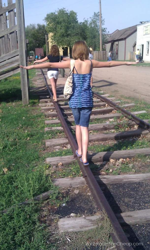 Walking on train tracks at Old Cowtown Museum (These tracks are not in use by real trains.)