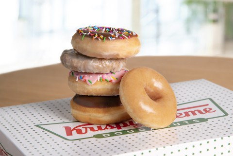 National Donut Day deal from Krispy Kreme - picture shows a stack of assorted Krispy Kreme doughnuts