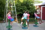 botanica spinning chairs in front of windmill opt